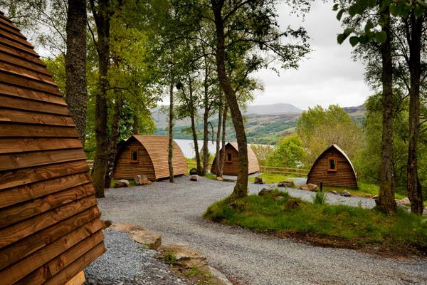 Some wooden wigwams in the forest at Loch Tay near Killin