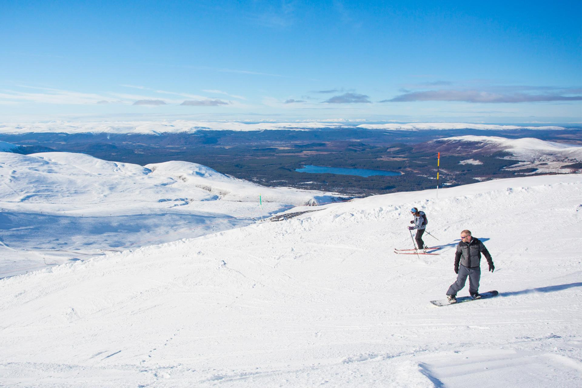 167a2bb339 Snowboarders with views across the Cairngorms