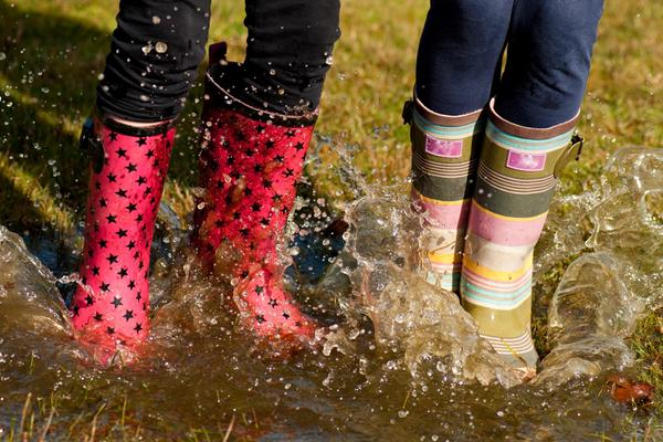 Children jumping in puddles © MikeKinsey/DollarPhotoClub