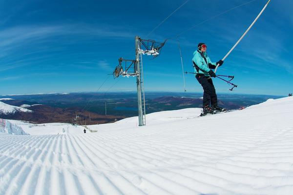 A skier on the M1 Poma tow after late season snow at the CairnGorm Mountain in the Highlands