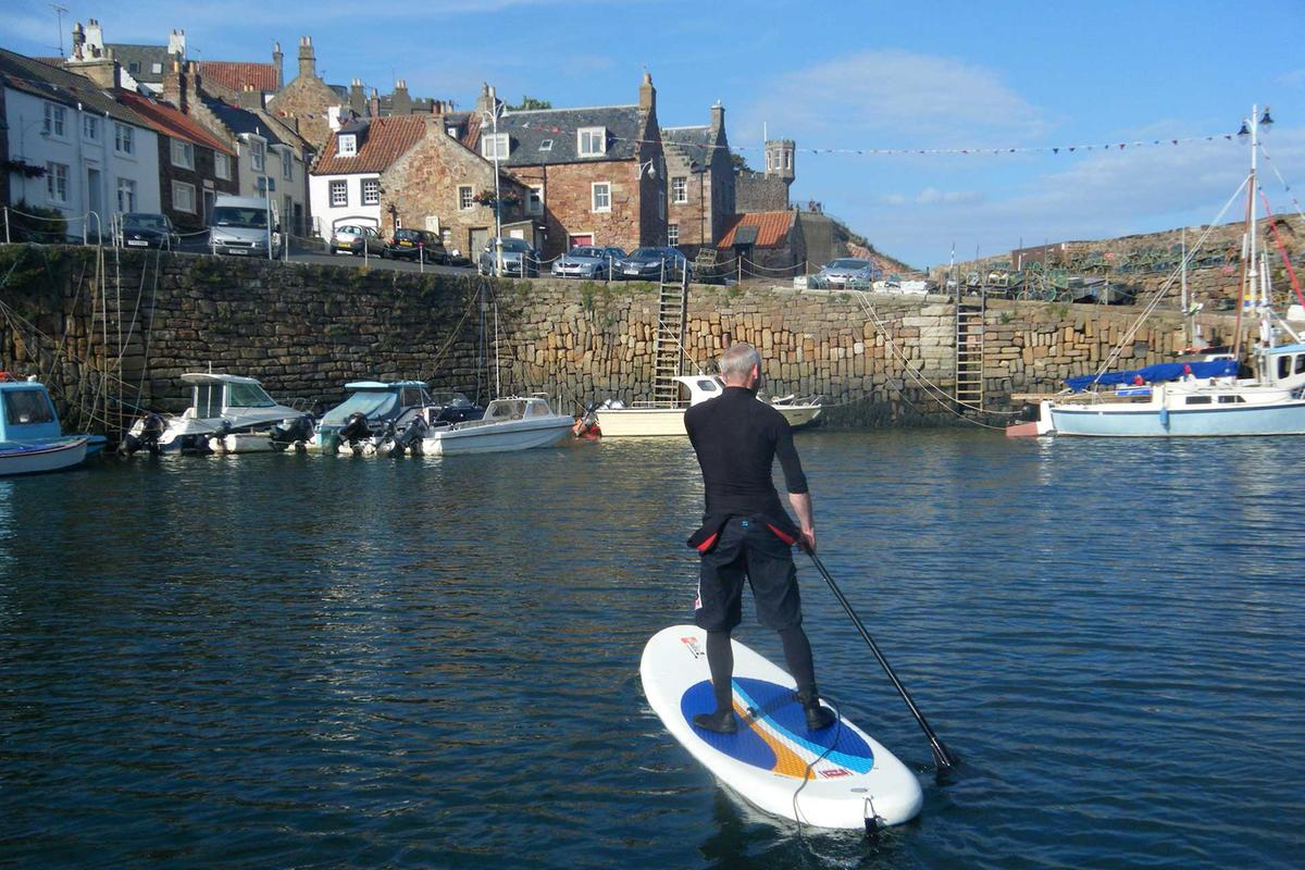 Stand up paddleboarding in Crail Harbour, East Neuk of Fife