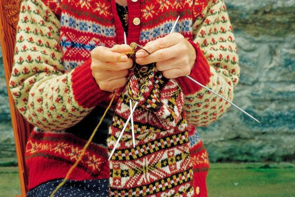 A woman knitting at the Shetland Textile Museum at Weisdale Mill
