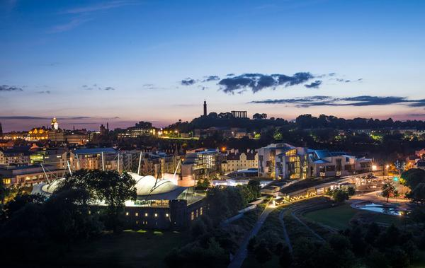 Edinburgh's skyline including Calton Hill and the Scottish Parliament buildings seen from Salisbury Crags