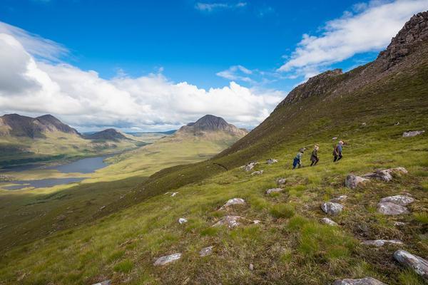 Walkers climb Stac Pollaidh, Wester Ross