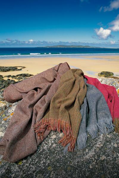 Harris Tweed scarves arranged on a rock by the sandy beach at Traigh An Iar, Isle of Harris, Outer Hebrides