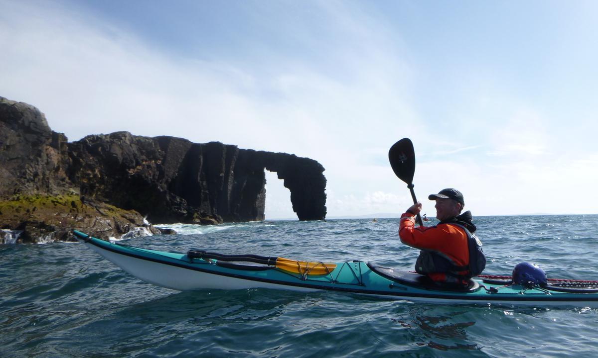 Kayaking, Dore Holm sea stacks, Eshaness, Shetland