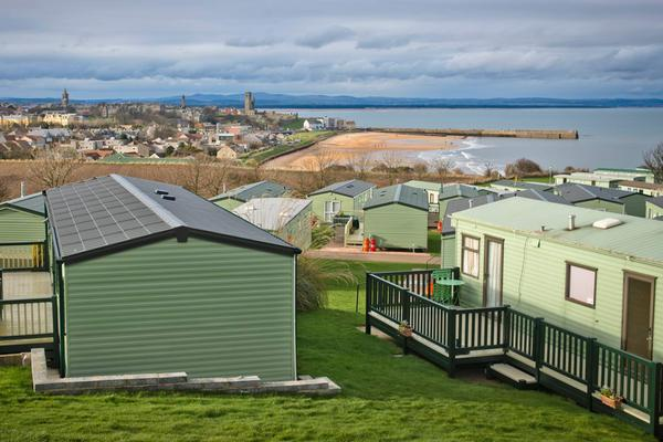 Grey skies over St Andrews Holiday Park with St Andrews beach in the distance, St Andrews