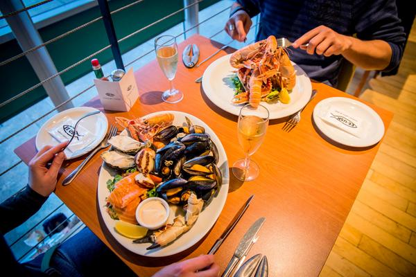 A couple dining at Ee-Usk, a seafood restaurant in Oban, Argyll & The Isles