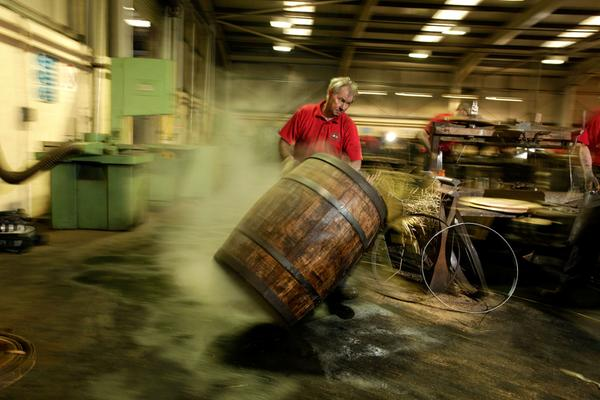 Coopers at work in the workshop at the Speyside Cooperage, Craigellachie, Moray