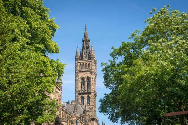 Glasgow University through the trees on a sunny day