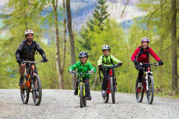A family of mountain bikers enjoying a day at Glentress Forest