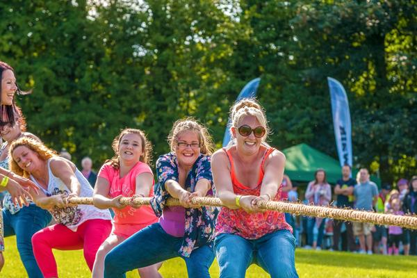 A group of ladies take part in the Tug o' war at Dundonald Highland Games in Ayrshire © Ayrshire & Arran Tourism Team