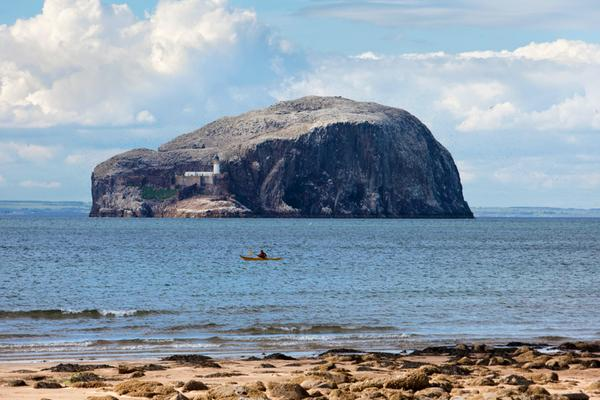 Sea kayaking off Seacliff beach, with a view to the Bass Rock beyond, in East Lothian