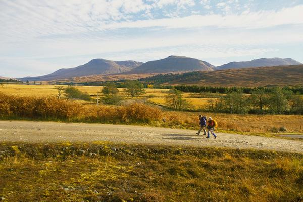Looking over two walkers on a section of the West Highland Way between the Inveroran Hotel and Forest Lodge, Argyll