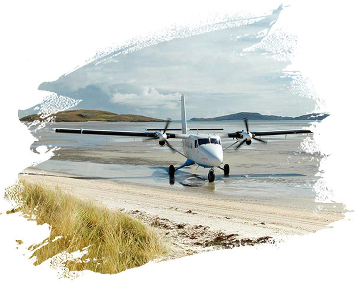 A plane sitting on the sand at Barra Airport on Traigh Mhor Beach, Isle of Barra