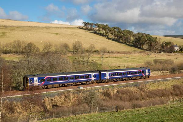 A train travels along the Borders Railway line