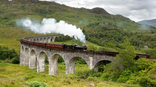 The Jacobite steam train passes over the Glenfinnan Viaduct at the head of Loch Shiel, Lochaber, Highlands