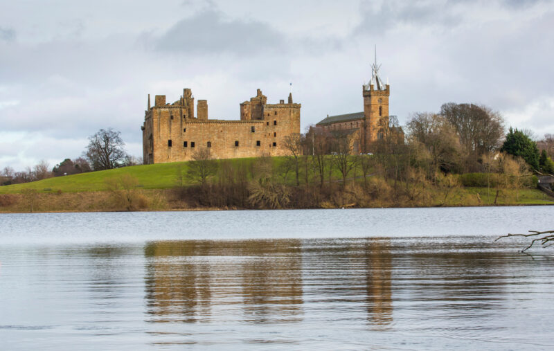 Linlithgow Palace and St Michaels Parish Church with its Distinctive Spire by Linlithgow Loch