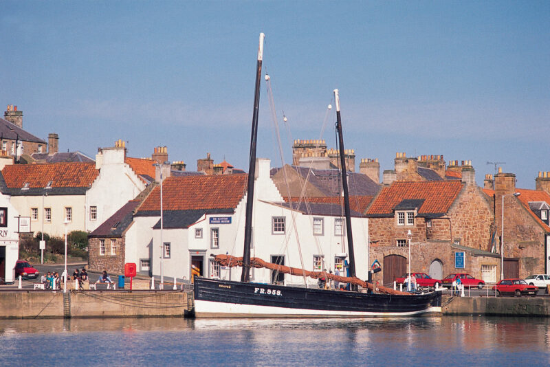 Looking Across The Harbour At Anstruther To A Moored Sailing Boat The Scottish Fisheries Museum Behind Fife