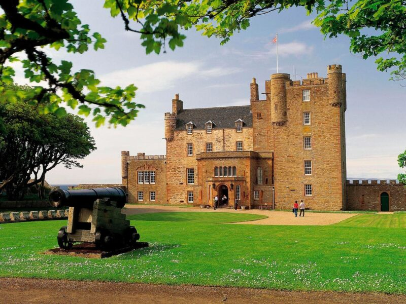 Looking Over An Ornamental Cannon To The Castle Of Mey View 1