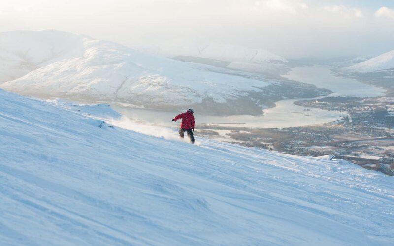 Stuart Kerr Of Glasgow Snowboarding The Nevis Range With Loch Linnhe And Eil Behind