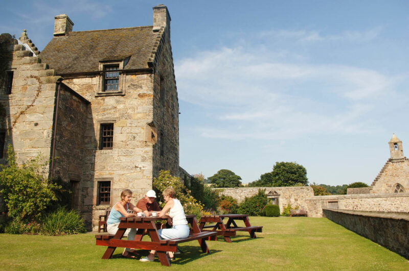 Visiters Enjoy A Cup Of Tea Outside Aberdour Castle Aberdour Fife