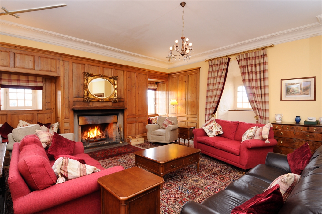Traditional living room with roaring fire