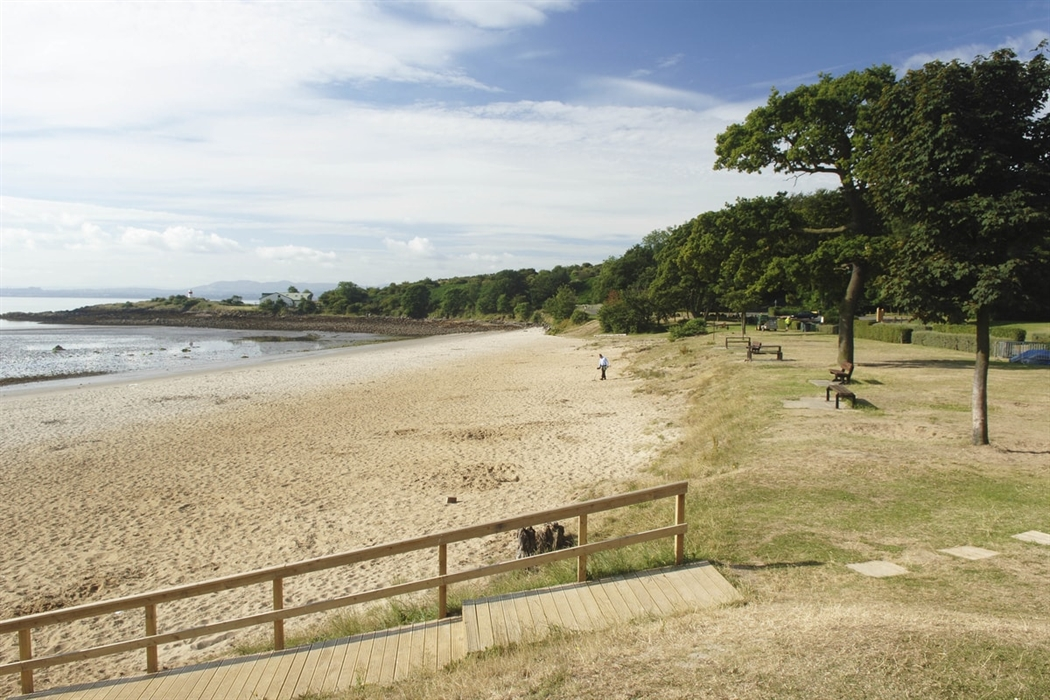 Silversands Beach On A Quiet Day Wooden Walkway Crosses The Sand Towards Sea And Pale Gold Stretches Into Distance